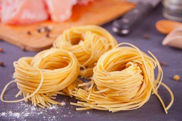 Italian egg pasta nest on black background