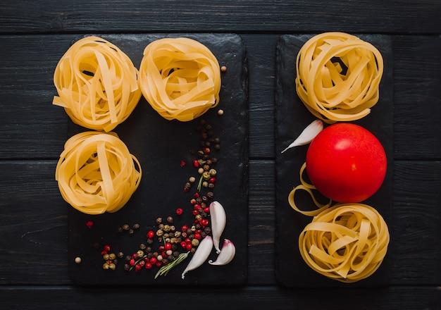 Italian food background on black stone table