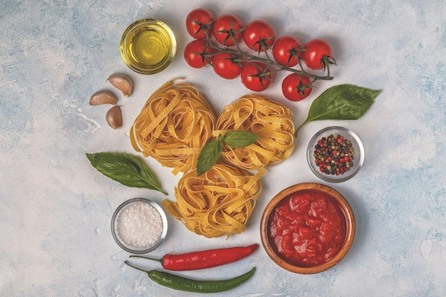 Italian food background with pasta, spices and vegetables