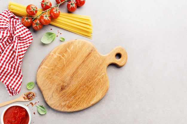 Italian food background with spaghetti on grey