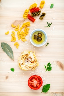 Italian food concept various kind of pasta on wooden background.