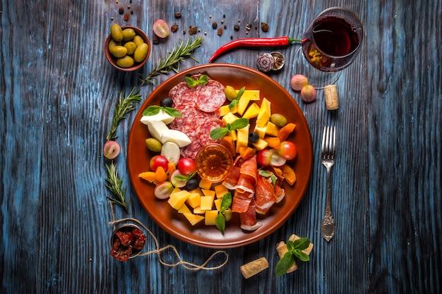 Italian food cooking ingredients on dark rustic wooden background