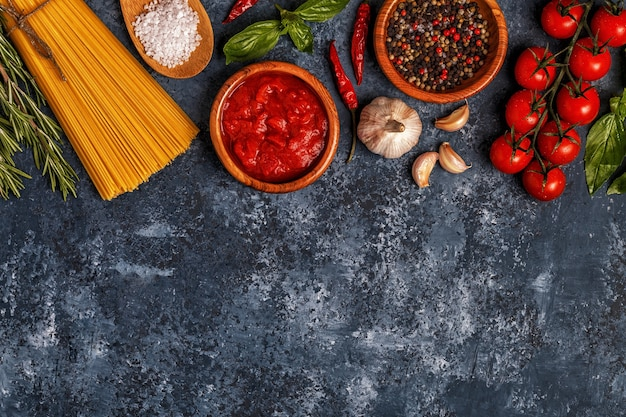 Italian food with pasta, spices and vegetables