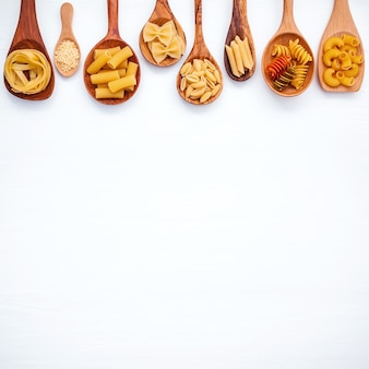 Italian foods concept and menu design. Various kind of Pasta on white wooden background