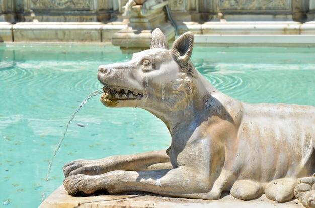 Italian fountain with stone wolf