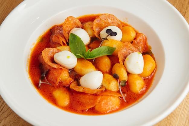 Italian gnocchi in tomato sauce with mozzarella