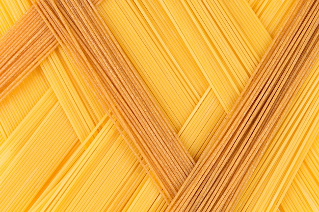 Italian long spaghetti top view abstract background of different colors