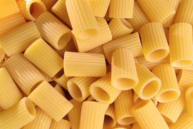 Italian macaroni pasta half sleeves striped raw food background or texture close up