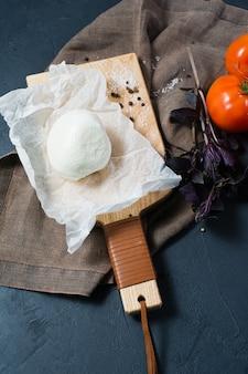 Italian mozzarella cheese, tomatoes, basil. ingredients for caprese salad.