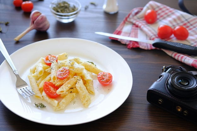 Italian pasta, camera. shooting food for blogger content.