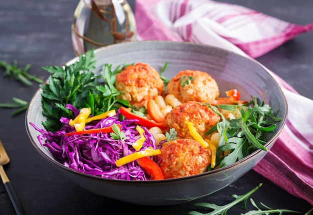 Italian pasta. cavatappi with meatballs and salad. dinner. slow food concept