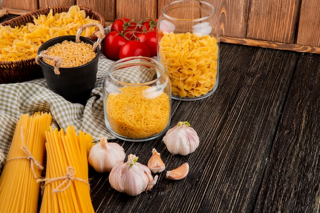 Italian pasta farfallini stelline fellini spaghetti linguini garlic side view copy space