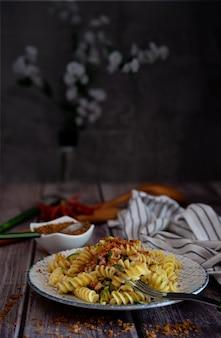 Italian pasta fusilli with zucchini and bread crumbs