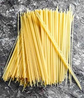 Italian pasta on gray concrete background