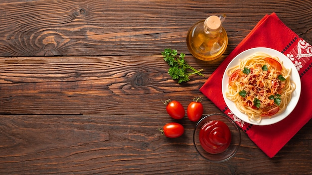 Italian pasta on rustic wooden background. flat lay. top view.