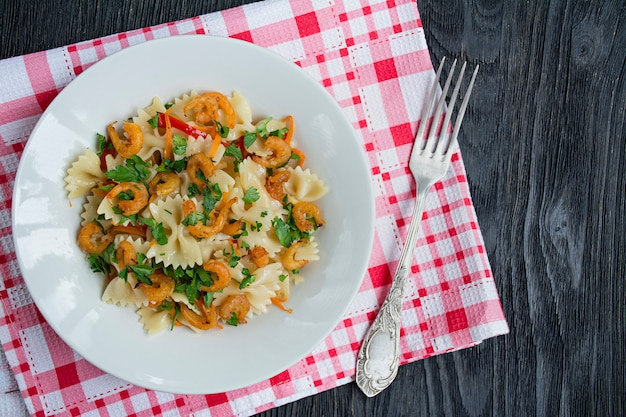 Italian pasta in a sauce with shrimps on a plate,