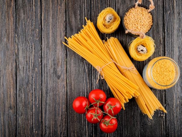 Italian pasta spaghetti linguini fellini tagliolini stelline tomato top view copy space