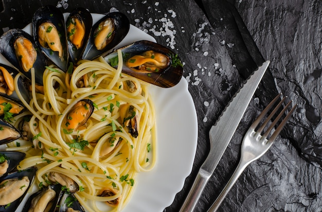 Italian pasta spaghetti with mussels and parsley. delicious food concept.