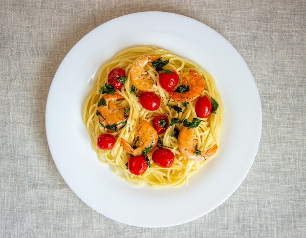 Italian pasta spaghetti with shrimps and tomatoes. national cuisine.