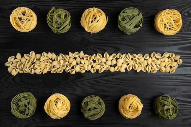 Italian pasta varieties on the black table
