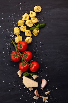 Italian pasta with cheese, basil and tomatoes