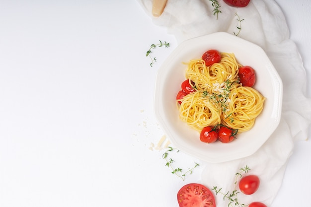 Italian pasta with fried cherry tomato and thyme