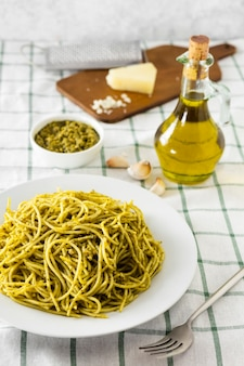 Italian pasta with olive oil bottle and cheese