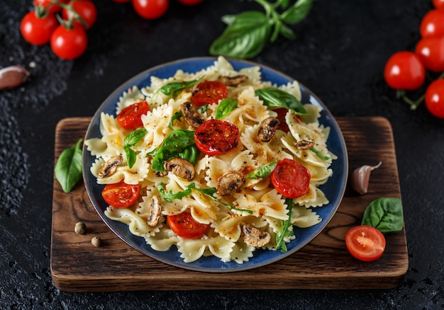 Italian pasta with sauce, cherry tomatoes, basil and parmesan cheese. delicious pasta plate