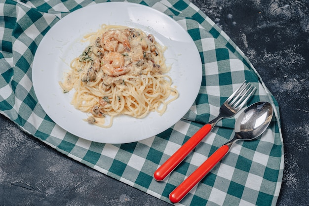 Italian pasta with seafood and king prawns, spaghetti with sauce
