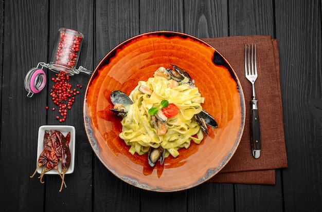 Italian pasta with seafood and sauce in a restaurant