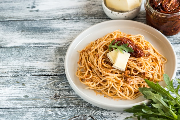 Italian pasta with sun-dried tomato pesto and cheese.