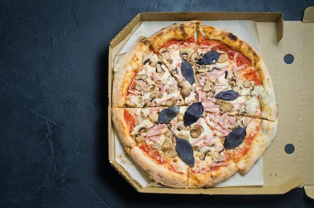 Italian pizza in a cardboard box