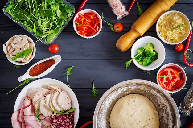 Italian pizza.  dough and pizza ingredients.