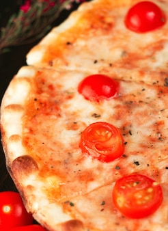 Italian pizza margherita with cherry tomatoes