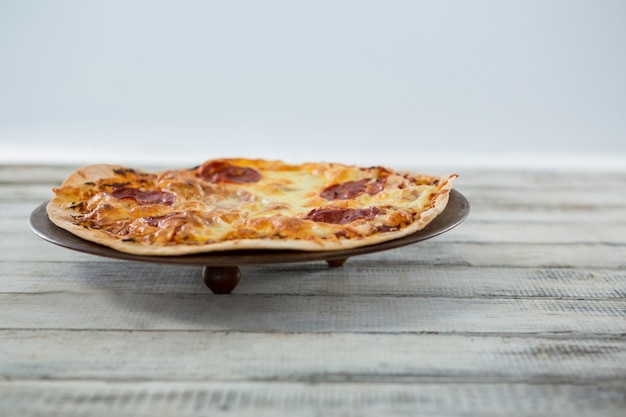 Italian pizza served in a pan