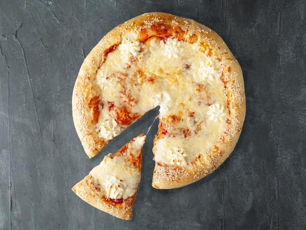 Italian pizza with sweet pear mozzarella dutch cheese philadelphia cheese sulguni cheese