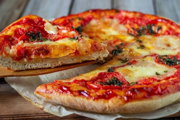 Italian pizza with tomatoes and mozzarella cheese. italian cuisine. margherita.