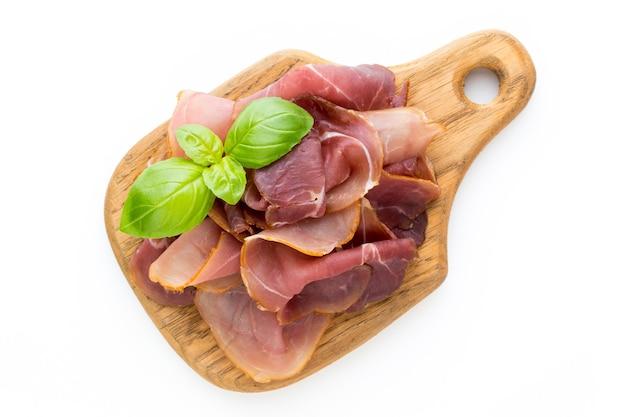 Italian prosciutto crudo or jamon. raw ham. isolated on white surface