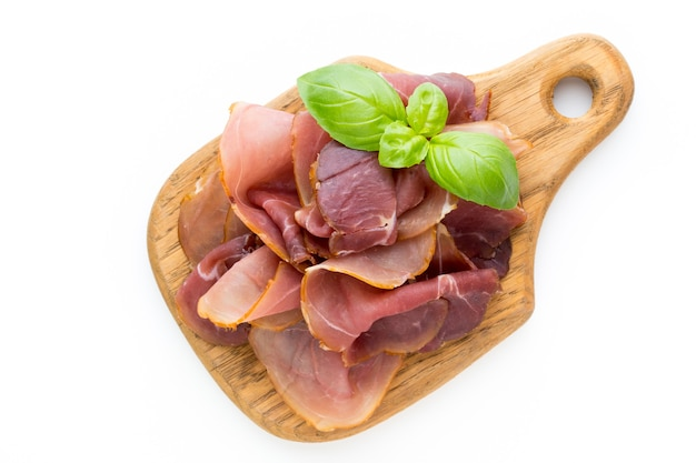 Italian prosciutto crudo or jamon. raw ham. isolated on white surface