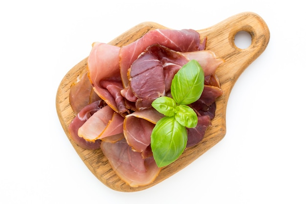 Italian prosciutto crudo or jamon. raw ham isolated on white
