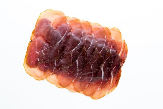 Italian prosciutto crudo or jamonon white. top view