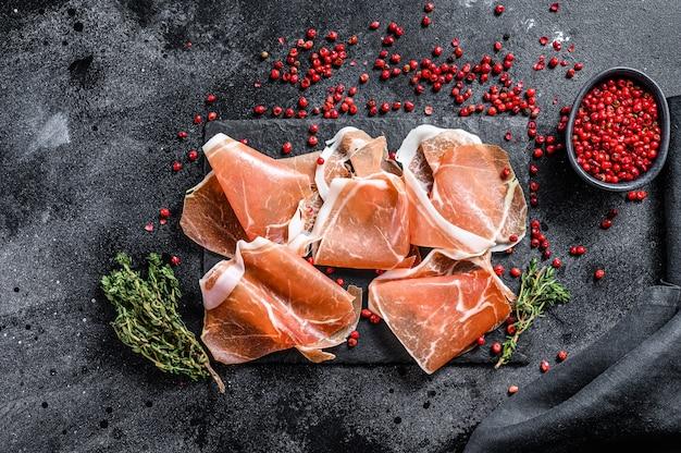 Italian prosciutto crudo with thyme, cured ham