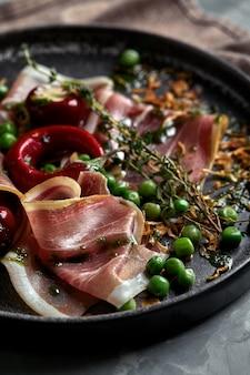 Italian prosciutto and ham with rosemary