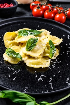 Italian ravioli pasta with cheese and basil