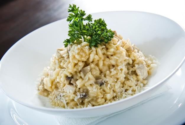Italian rice arborio risotto with leek on white table