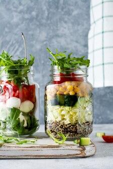 Italian salad of arugula, mozzarella and cherry tomato served in a jar