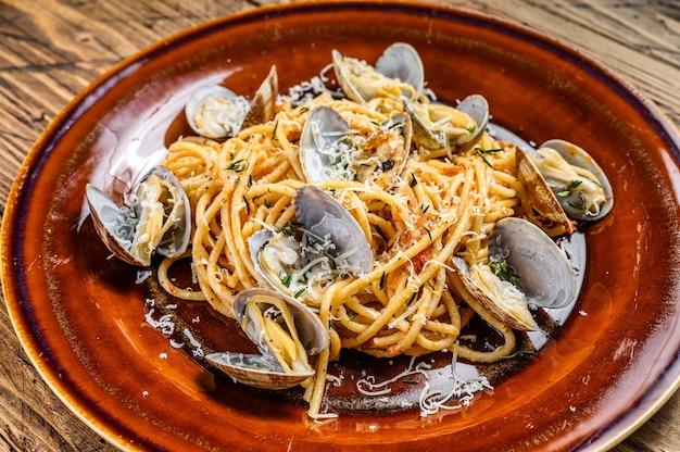 Italian seafood spaghetti pasta with clams  in a rustic plate