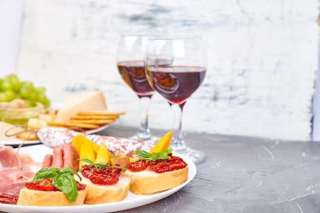 Italian snacks set with red wine