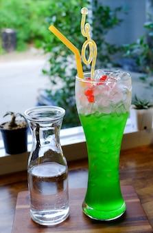 Italian soda, kiwi soda with ice.