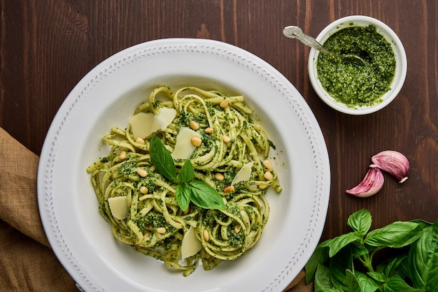 Italian spaghetti pesto with pine nuts garlic basil leaves parmesan cheese and olive oil